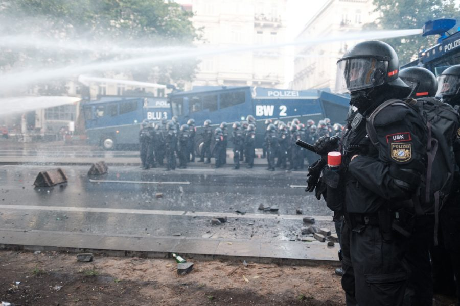 Police uses water cannons to disperse rioters