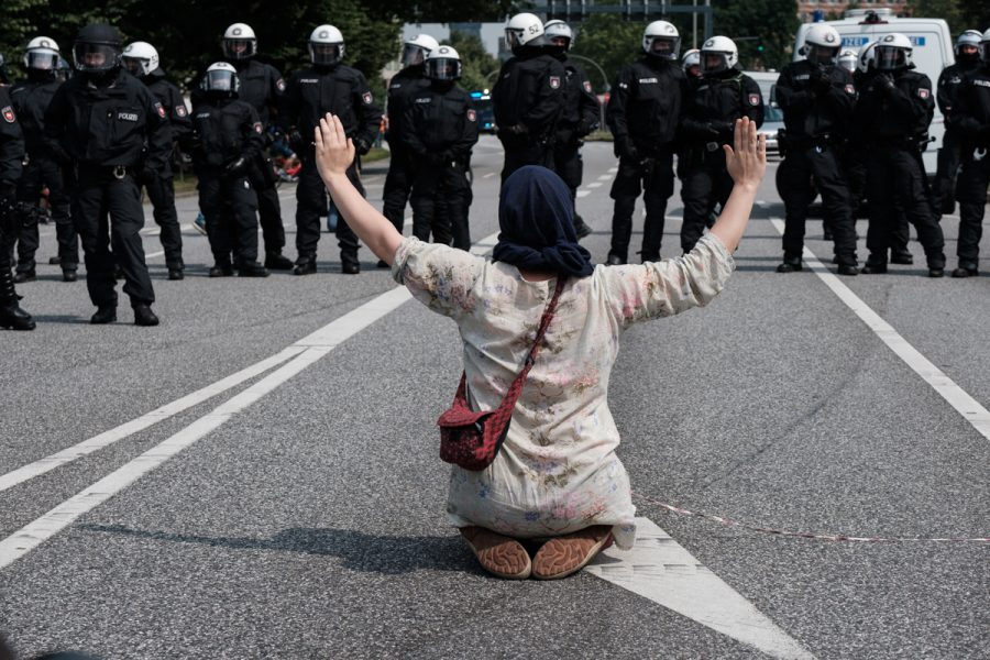 Protester facing riot police