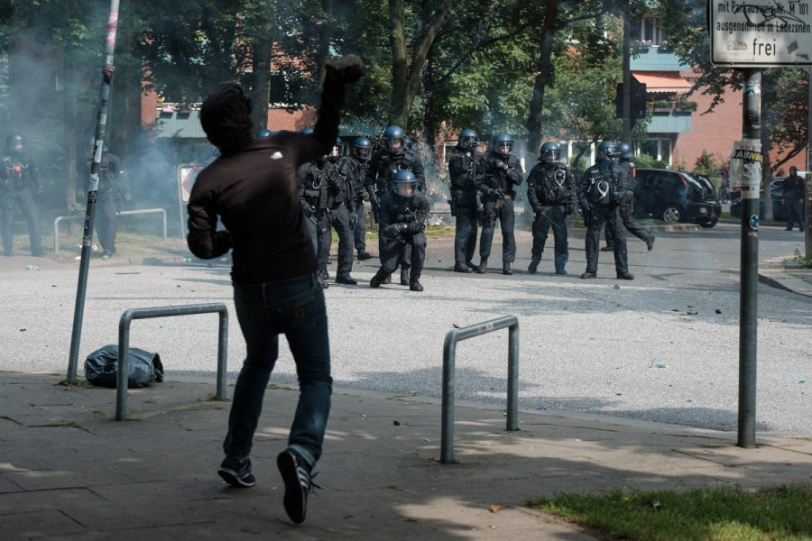 Protesters throw rocks, bottles and firecrackers at the police