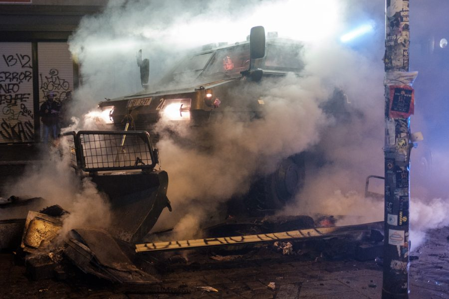 Police vehicle demolishing a barricade