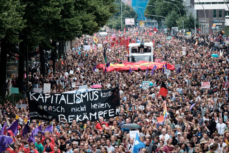 Tens of thousands of protesters rally through Hamburg